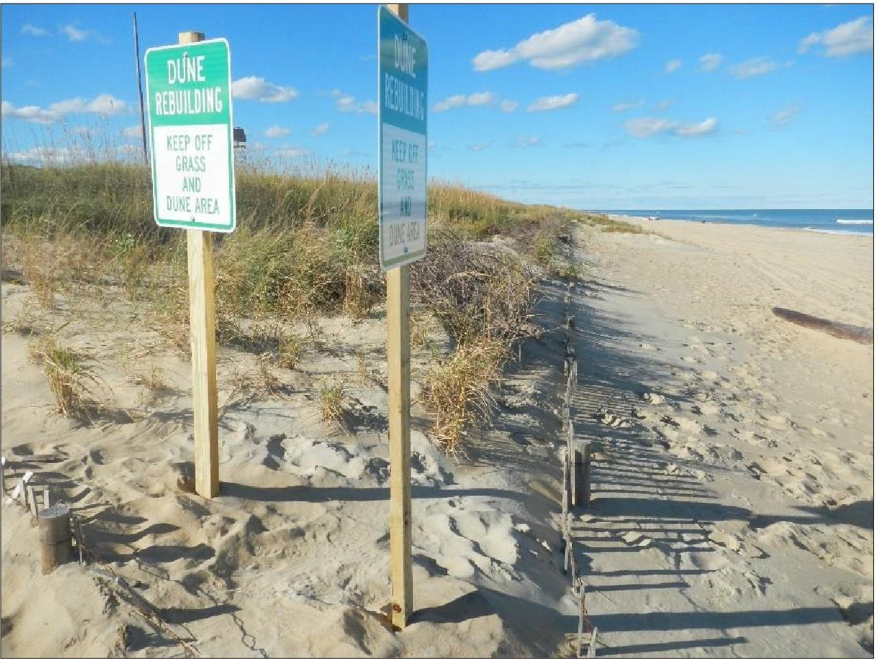 Habitat restoration signs on restored dune.